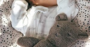 Read more about the article 9 Sustainable, Organic Newborn Zipper Onesies
